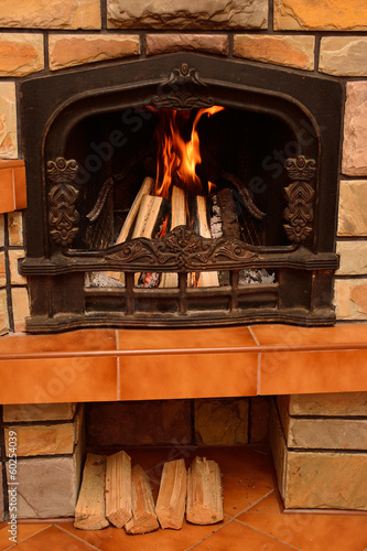 Home fireplace, burning logs, cozy atmosphere