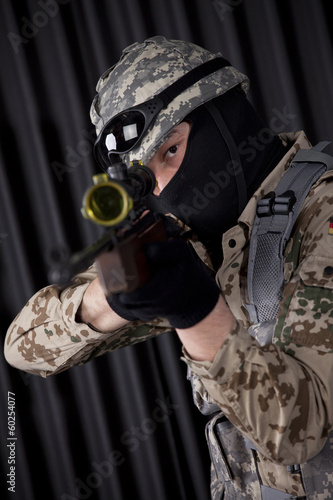 Soldier with rifle aiming