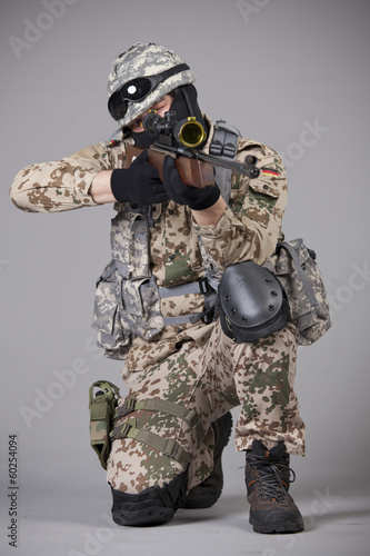 Sniper with rifle aiming