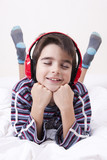 boy lying in the room with music headphones