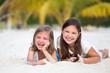 Happy little girls enjoy summer day at the beach