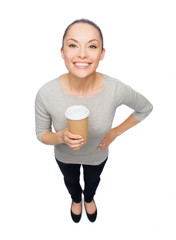 smiling asian woman with take away coffee cup