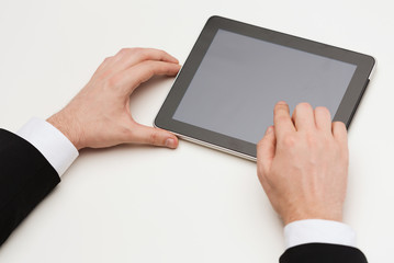 close up of man hands touching tablet pc