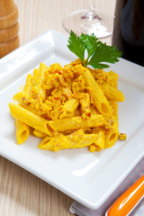 Penne with speck and saffron