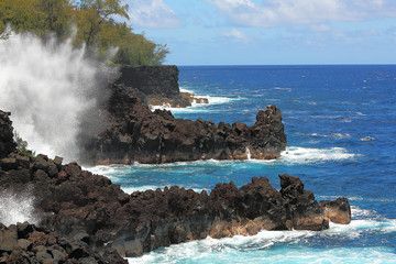 Ocean waves along the lava rock shore of Hawaii