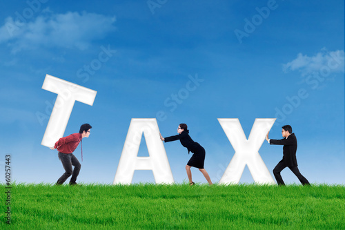 Business team builds a tax word