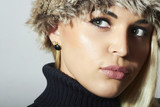 Beautiful Blond Woman in Fur. Beauty Fashion Girl. Winter