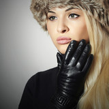 Fashion Girl in Fur.Beautiful Blond Woman in Leather Gloves