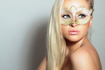 Beautiful Blond Woman in Carnival Mask.Holiday.Sexy Girl