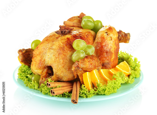 whole roasted chicken with lettuce, grapes, oranges and spices