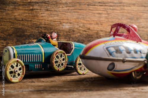 Old tin toys  on old wood background