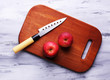 Kitchen knife and red apple,   on wooden background