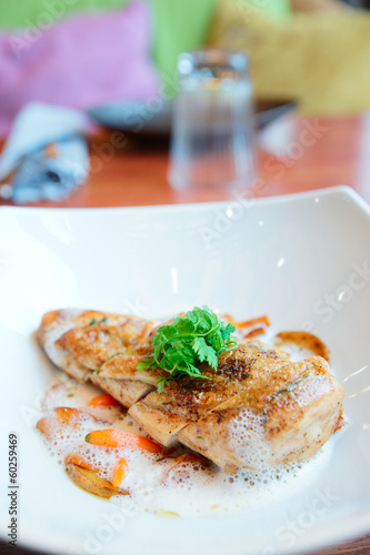 Fried chicken breast with vegetables and froth sauce