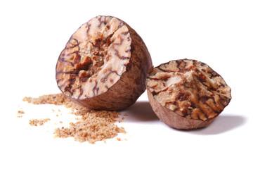 chopped and ground nutmeg isolated on white background