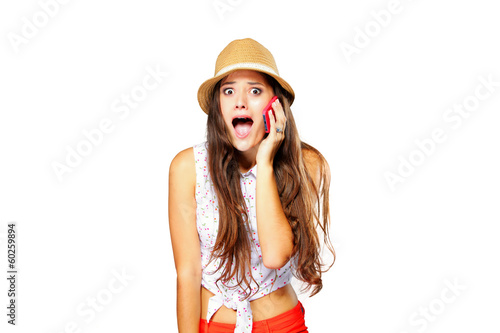 surprised emotional girl talking on mobile phone isolated