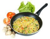Omelet with vegetables isolated on white