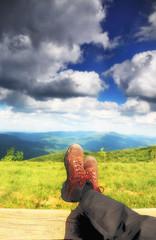 Hiking shoes. Hiker enjoying view relaxing