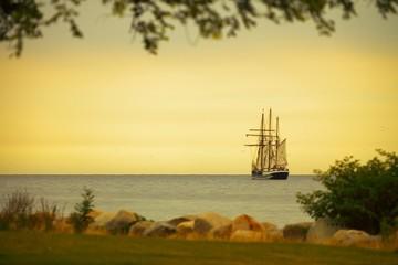 Beautiful sailing ship on sea at dusk