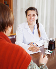 doctor listening patient  at table