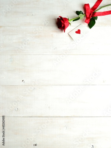 Red rose with message card.Valentines day season