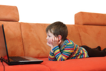 boy is watching a computer screen