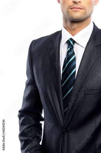 Well-dressed man in black suit and tie