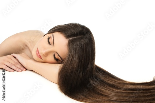 Beautiful young girl with long hair isolated on white