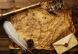 Sextant, spyglass and envelope on vintage map