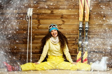 Happy woman with skis and ski boots