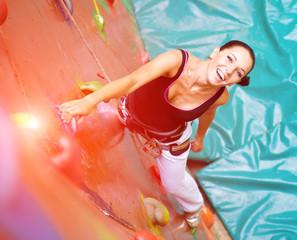 women climbing on a wall