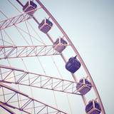 Ferris wheel and blue sky with retro filter effect