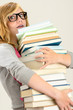 Worried student girl carry stack of books