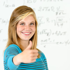 Smiling student girl thumb up mathematics board