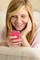 Happy teenage girl in love receive SMS
