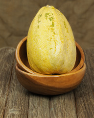 Big marrow squash  in bowl on wooden background.
