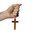 Male hand holding wooden cross on white background