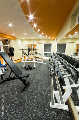 Interior view of a gym with equipment.