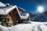 Fototapety winter ski chalet and cabin in snow mountain  landscape in tyrol