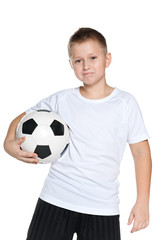 Confident boy with soccer ball