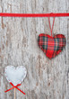 Valentine card with textile hearts on old wood