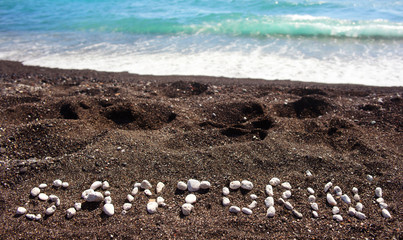 Text Santorini made ​​with pumice stones
