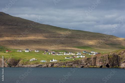 Faroe Islands, remote village on a rocky cliff