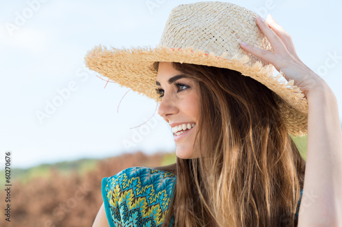 Young Woman Wearing Straw Hat