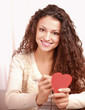 Beautiful smiling caucasian woman with heart symbol