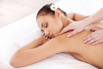 Enjoying massage at spa.
