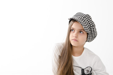 portrait of a girl in a checkered cap in studio