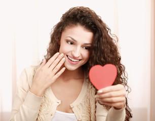 Beautiful smiling caucasian woman with heart symbol