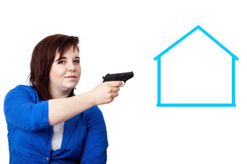 Woman holding gun in the direction of symbolic house