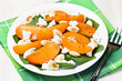 Spinach persimmon goat cheese salad with almonds