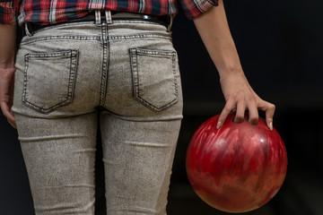 Close-Up Of A Butt Next To A Bowling Ball
